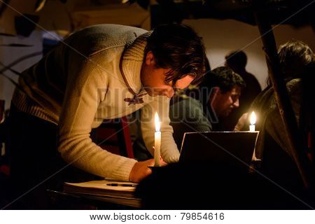 KATHMANDU, NEPAL - JANUARY 11, 2015: Man signing the condolences book at  the Cafe des Arts gathering in tribute to the victims of the terrorist attacks in Paris.