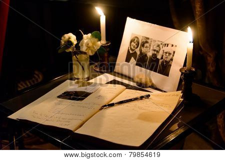 KATHMANDU, NEPAL - JANUARY 11, 2015: Photos of Cabut, Tignous, Charb and Wolinski and the condolences book at Cafe des Arts. The cartoonists were killed during the attack at Charlie Hebdo in Paris.