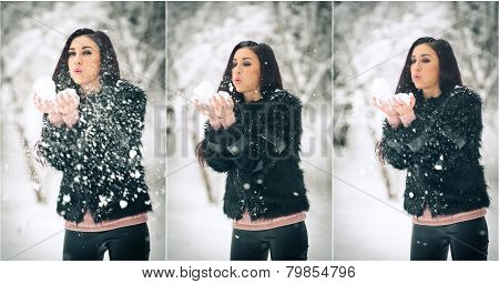 View of happy brunette girl playing with snow in winter landscape