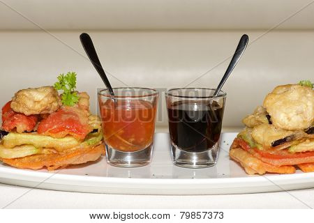 Two Sauce Glasses Between Tempura Fried Vegetables
