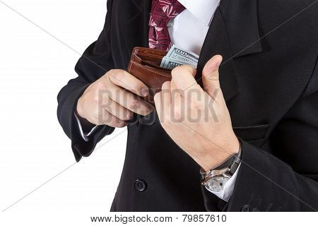Male hands put the purse in his pocket