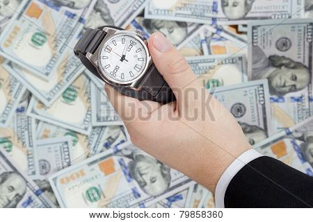 Wristwatch on dollars background