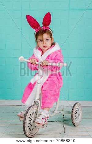 Girl standing on small bike