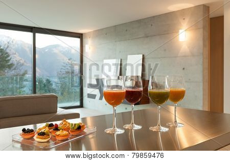 Interior modern house, aperitif with pastries