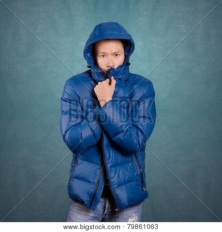 Asian man in blue down-padded coat