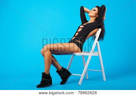 Pretty Girl In Swimsuit Sitting On A Chair