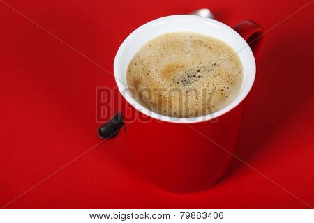 Red coffee cup on red background