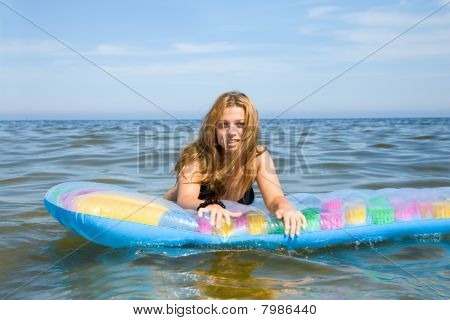 Beautiful girl swimming on in  baltic sea
