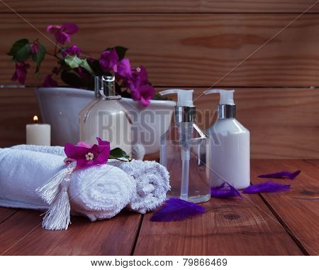 Bathroom and Spas, towels, bath on wooden background