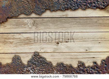 Wooden board among rusty metal
