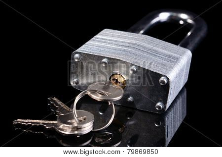 Padlock with keys isolated on black