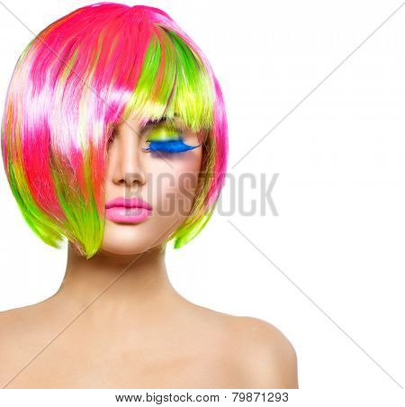 Beauty Fashion Model Girl with Colorful Dyed Hair. Haircut with fringe. Colourful short Hair. Portrait of a Beautiful Girl with Dyed Hair, professional hair Coloring. Colouring hair
