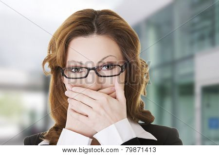Beautiful woman in glasses shocked