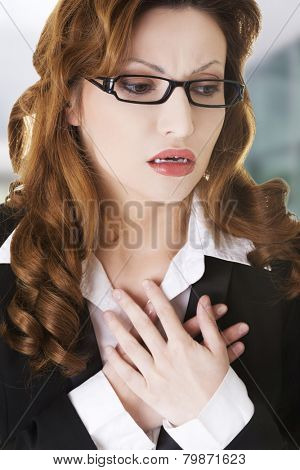Young businesswoman having heart disease