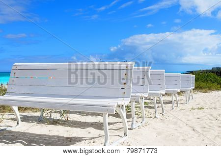 White Wooden Benches At The White Sandy Beach In Cuba