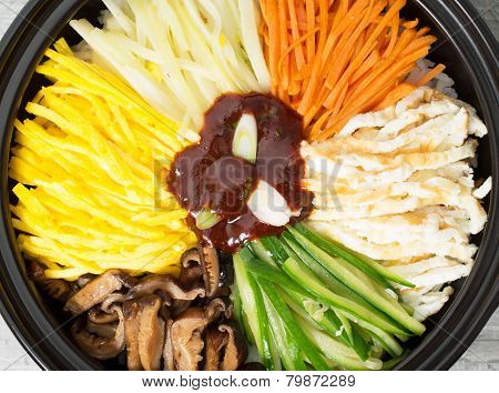 Top View Close Up Traditional Korean Bibimbap In  A Clay Pot