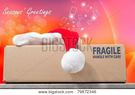 Season's Greetings With A Christmas Purchase In A Brown Box On A Wooden Table