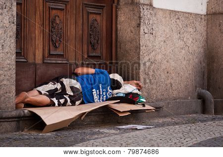 Homeless man sleeping at the church entrance