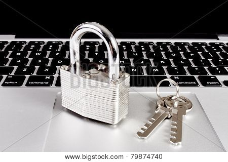 Modern Laptop With Closeup Of Lock And Key
