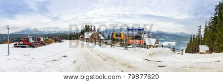 ZAKOPANE, POLAND - JANUARY 6, 2014: Panorama of Male Ciche ski resort near Zakopane. Male Ciche is a village in Tatra Mountains and very popular ski resort in the winter time.