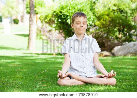 Boy engaged in yoga. Meditation