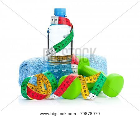 Two green dumbells, tape measure and drink bottle. Fitness and health. Isolated on white background