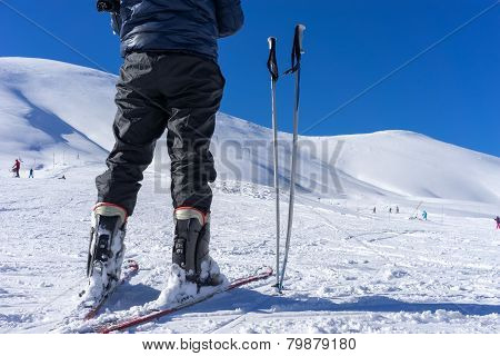 Ski Poles Near A Skier On The Mountain Falakro, In Greece.