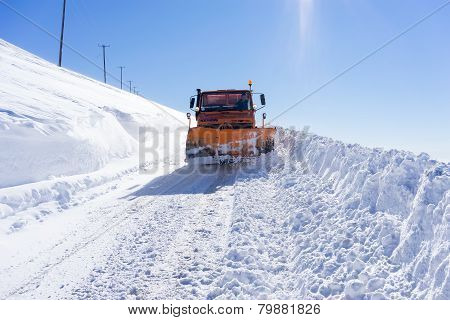 Snowmobile Moving Snow To Clear The Roads In Falakro Ski Center, Greece. The Ski Resort Of Falakro M