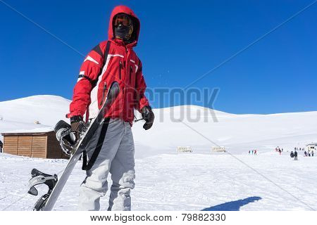 Skier In Front Of The Mountain At Falakro Ski Center, Greece.