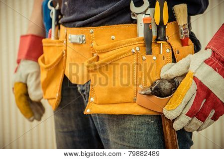 man with tools in leathern belt