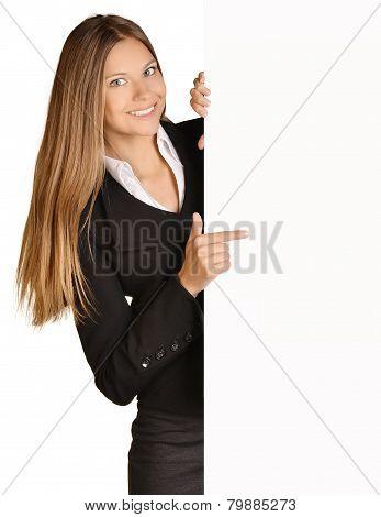 Business girl shows forefinger hand on the blank banner.