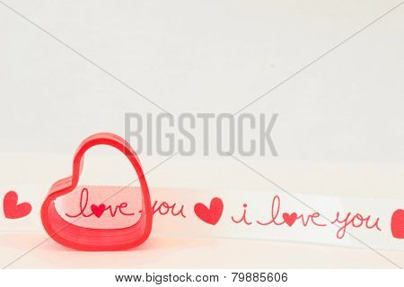 red spring heart with I Love you ribbon