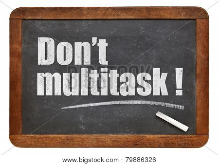 Do not multitask!  - white chalk text  on a vintage slate blackboard