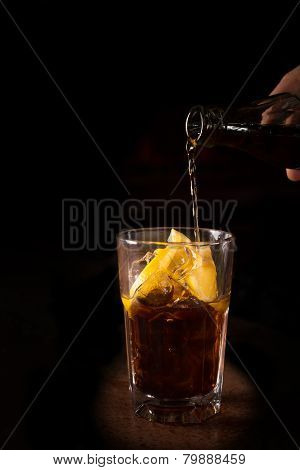 Barman Prepares Cuba Libre Cocktail In A Tall Glass