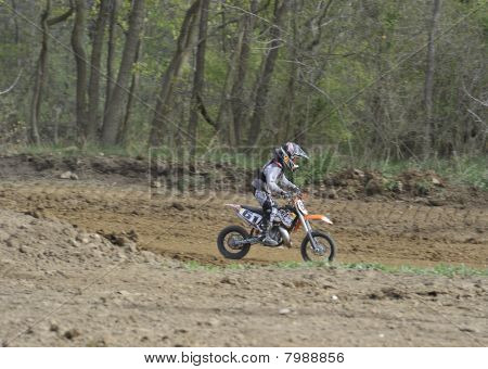 Motocross Racer Riding On A Dirt Track