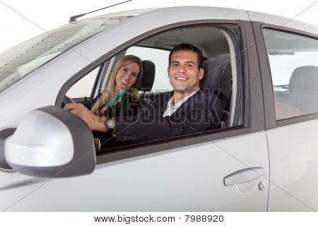 Couple Inside A Car