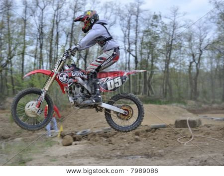 Motocross Racer Jumping Over A Small Hill