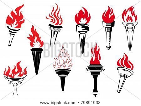 Vintage torches with burning flames