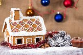 image of gingerbread house  - traditional gingerbread house on a background of Christmas decorations - JPG