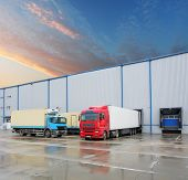 stock photo of building exterior  - Cargo truck at warehouse building at sunset - JPG