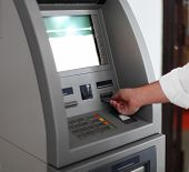 picture of automatic teller machine  - Close up of hand of a man using banking machine - JPG