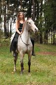 picture of appaloosa  - Beautiful girl riding a horse without bridle or saddle in autumn
