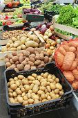 pic of crate  - Raw potato piles in crates sold on market - JPG