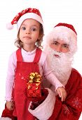 stock photo of dwarf  - Santa Claus and dwarf with a gift - JPG