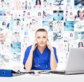stock photo of bad mood  - Tired and depressed doctor in medical office - JPG