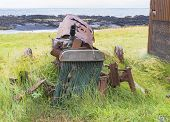 image of derelict  - Abandoned derelict tractor in advanced stage of rusting to pieces - JPG