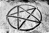 foto of pentagram  - Pentagram written in dust closeup photo in black and white - JPG
