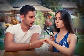 image of soulmate  - Young couple getting engaged in funny wedding proposal scene - JPG