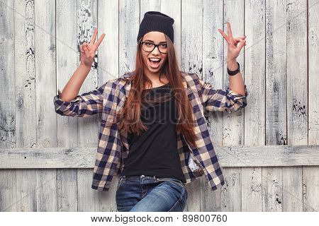 girl in glasses  show victory sign