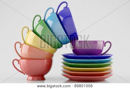 Colorful cups and saucers on white background